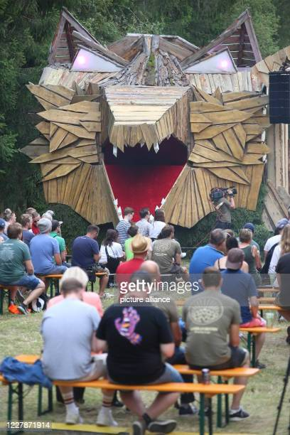 """August 2020, Saxony-Anhalt, Elend: BEseekers sit in front of the stage. The festival """"Rocken am Brocken"""" is only available as an online music..."""