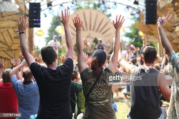 """August 2020, Saxony-Anhalt, Elend: Visitors sit in front of the stage. Due to the Corona pandemic, this year's """"Rocken am Brocken"""" festival is only..."""