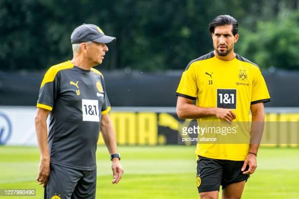 August 2020, Switzerland, Bad Ragaz: Football: Bundesliga, training camp of Borussia Dortmund. Coach Lucien Favre talks to Emre Can. Photo: David...