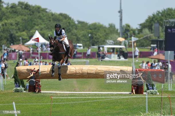 August 2021, Japan, Tokio: Equestrian/Eventing: Olympic, Preliminary, Cross Country, on the Sea Forest XC Course. Michael Jung from Germany on...