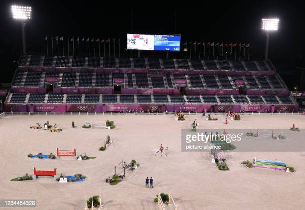 August 2021, Japan, Tokio: Equestrian/Jumping: Olympics, Individual, Final at Equestrian Park. Through the Pakour. Japan's Eiken Sato rides Saphyr...
