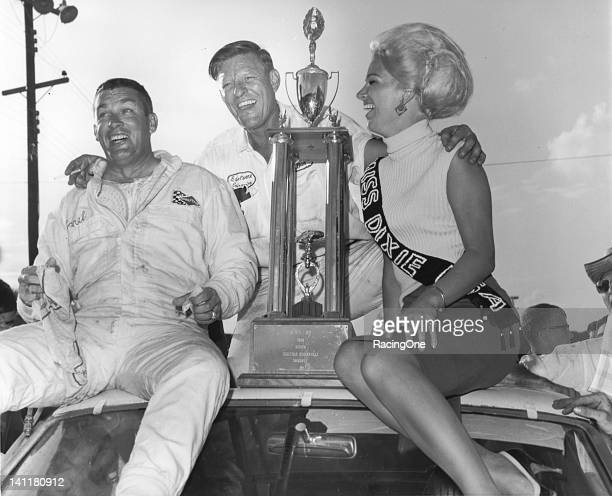 Darel Dieringer is joined by car owner Bud Moore and Miss Dixie USA after he won the Western North Carolina 500 NASCAR Cup race at...