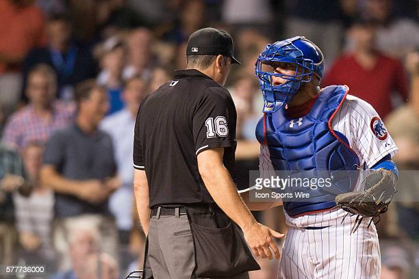 Chicago Cubs catcher Welington Castillo [8057] argues with umpire Mike DiMuro after San Francisco Giants Joaquin Arias [4607] scored during a game...