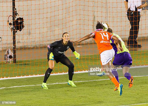 Houston Dash forward Jessica McDonald attempts to score with a header on Seattle Reign FC goalkeeper Hope Solo during the NWSL soccer match between...
