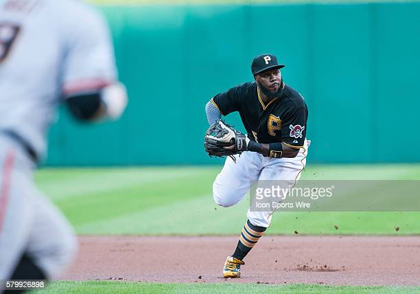 Pittsburgh Pirates third baseman Josh Harrison throws out San Francisco Giants first baseman Brandon Belt after he grounds out to second base during...