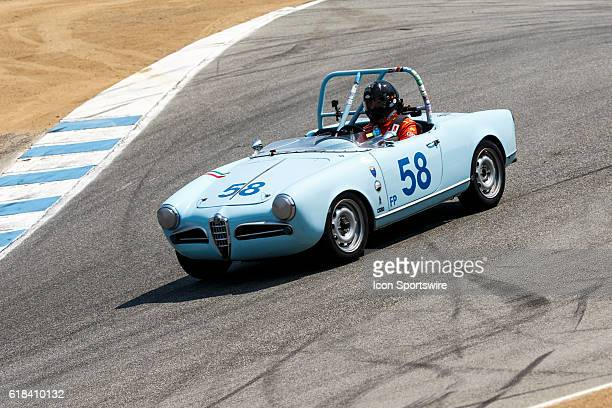 A 1957 Alfa Romeo Giulietta Spider driven by Jonathan Burke from Berkeley CA competed in Group 1B during Rolex Race 1B at the Rolex Monterey...