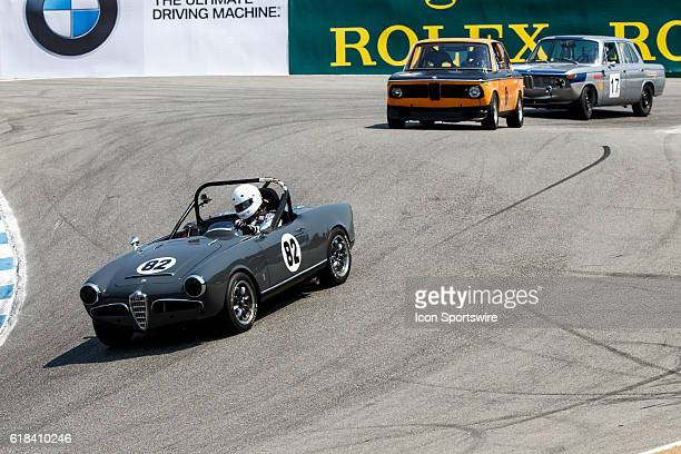 A 1964 Alfa Romeo Giulia Spider driven by Dave Brengle from San Diego CA competed in Group 4B during Rolex Race 4B at the Rolex Monterey Motorsports...