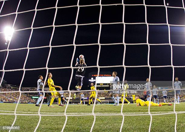 Tim Melia of the Sporting KCn jumping to save the ball in the box during the game between the Sporting KC and the Columbus Crew SC held at MAPFRE...