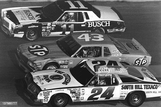Cale Yarborough races with Joe Millikan relief driving for Richard Petty in the No 43 and Cecil Gordon during the Busch Volunteer 500 NASCAR Cup race...