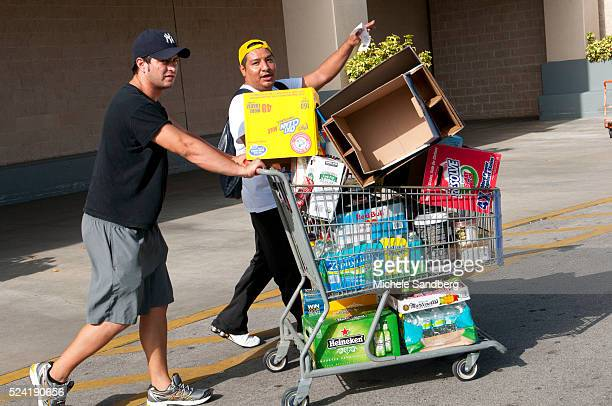 August 23 2012 ANDRES DIAZ AND RENEE CHAVEZ buy food beverages and supplies in preparation for Storm Isaac South Florida prepares for Storm Isaac