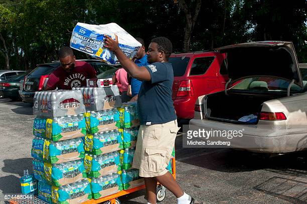 August 23 2012 RUDDENS CHERELUS IFRATHIEU ST LOUIS MARY AND EDGAR SIRENORD purchase food beverages and supplies in preparation for Storm Isaac South...