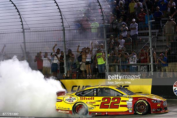 Joey Logano celebrates with a burnout after winning the Irwin Tools Night Race at the Bristol Motor Speedway