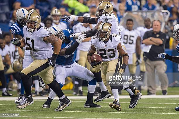 New Orleans Saints center Jonathan Goodwin is out in front blocking for New Orleans Saints running back Pierre Thomas during a week 3 preseason...