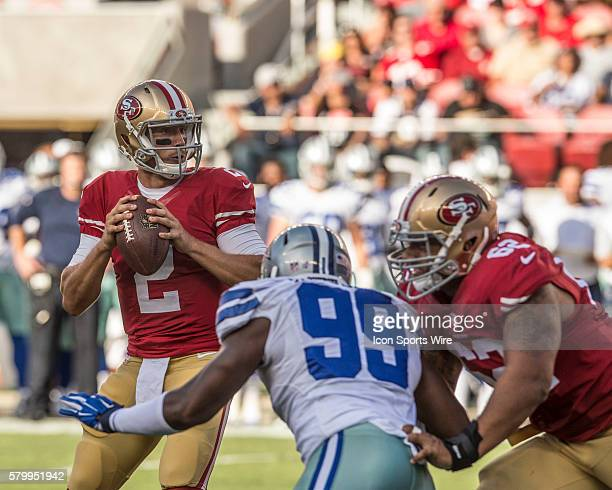 San Francisco 49ers quarterback Blaine Gabbert under pressure from Dallas Cowboys defensive end Ryan Russell on Sunday August 23 2015 at Levi's...