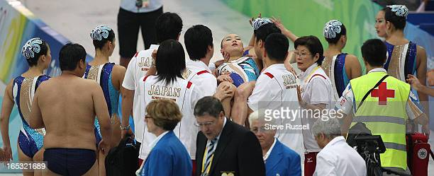 August 23 Lifeguards medics teammates and coaches assist Hiromi Kobayashi who fainted after being removed from the pool she started hyperventilating...