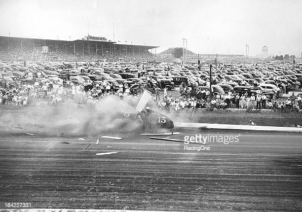 """August 24, 1941: Duke Nalon crashes his Alfa Romeo into the inside fence of the Milwaukee Mile, scattering wood in all directions during an AAA """"Big..."""