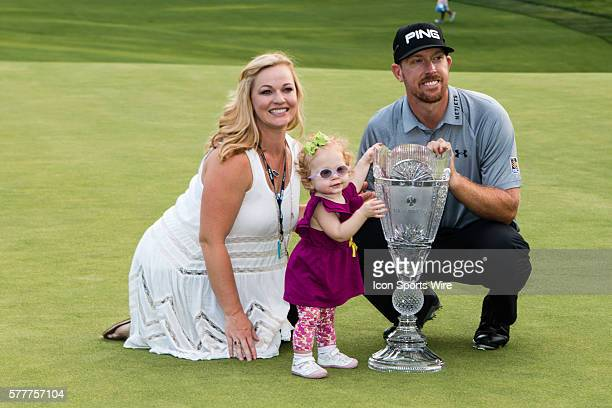 Hunter Mahan with wife, Kandie and daughter Zoe celebrate after winning The Barclays at 14 under at Ridgewood Country Club in Paramus, NJ.