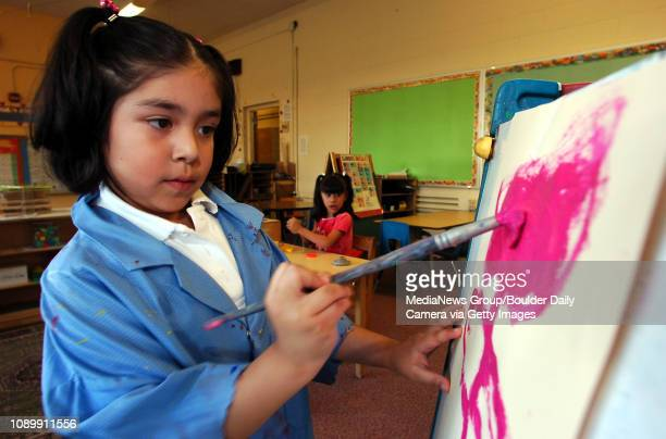 August 25 2004 / Boulder Co / Adela Aguirre paints a large pink flower during play time in Leslie Davis's kindergarden class at University Hill...