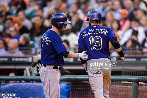 Colorado Rockies right fielder Charlie Blackmon celebrates scoring in the first inning with Colorado Rockies left fielder Corey Dickerson during the...