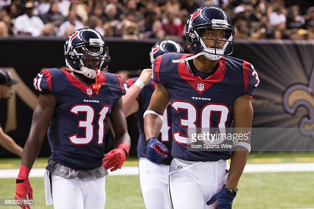 Houston Texans cornerback Kevin Johnson and defensive back Charles James during the game between the Houston Texans and New Orleans Saints at the...