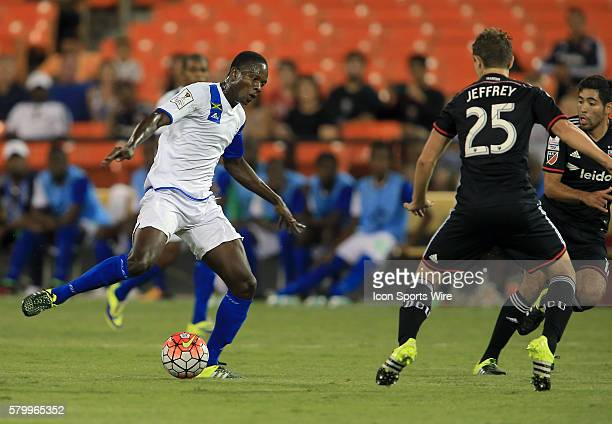 Jared Jeffrey of DC United defends against Winston Wilkinson of Montego Bay United during a CONCACAF Champions League match at RFK Stadium in...
