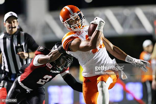 Bryan Burnham of the BC Lions tries to break free of an Ottawa Redblack tackle close to the end zone in Canadian Football League action at TD Place...
