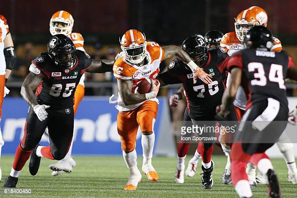 Cord Parks of the BC Lions runs up through the middle of the Ottawa Redblacks defence in Canadian Football League action at TD Place Stadium in...