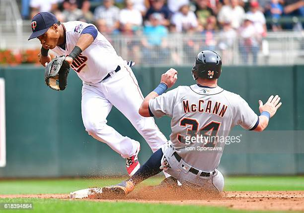 Detroit Tigers Catcher James McCann [9679] slides safely into second as Minnesota Twins Infield Jorge Polanco [8979] can't handle a throw from...