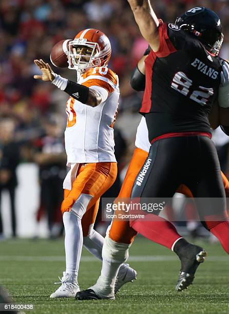 Jonathon Jennings of the BC Lions looks to pass the ball downfield against the Ottawa Redblacks in Canadian Football League action at TD Place...