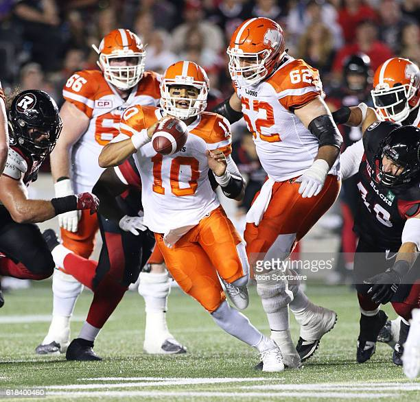 Jonathon Jennings of the BC Lions scrambles out of the pocket and looks to throw the ball against the Ottawa Redblacks in Canadian Football League...