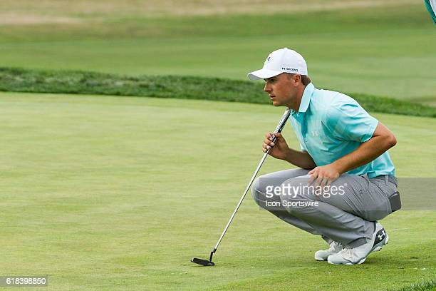Jordan Spieth lines up his pet on the 18th green during the first round of play at The Barclays on the Black course at Bethpage State Park in...
