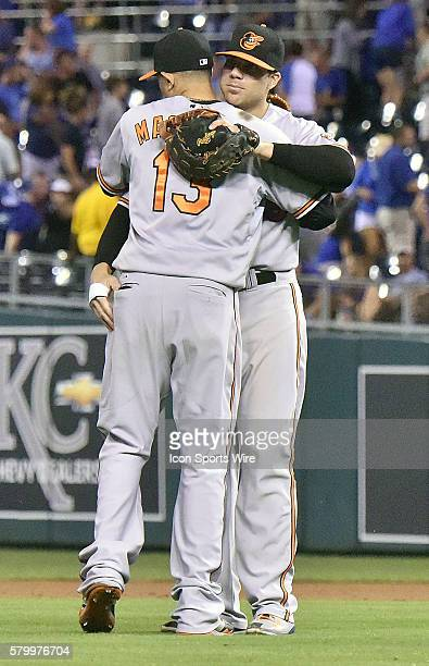Baltimore Orioles' first baseman Chris Davis hugs Baltimore Orioles' third baseman Manny Machado at the end of the game after a Major League Baseball...