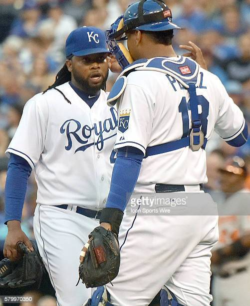 Kansas City Royals' catcher Salvador Perez talks to Kansas City Royals' starting pitcher Johnny Cueto during a Major League Baseball game between the...