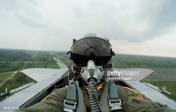 August 27, 2008 - An aerial combat photographer takes a self-portrait during a sortie over New Orleans, Louisiana.
