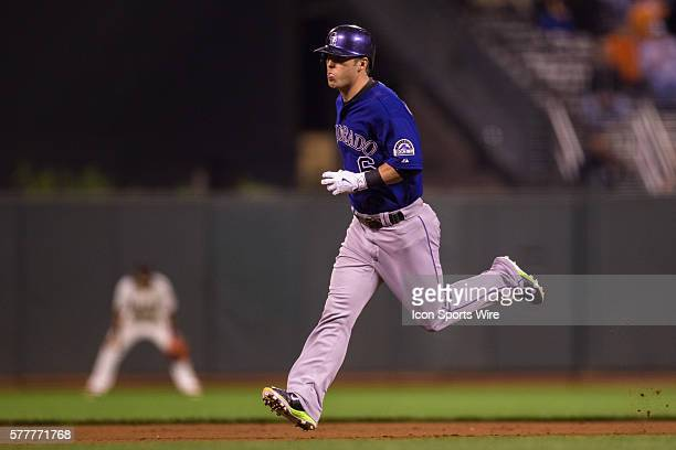 Colorado Rockies left fielder Corey Dickerson runs the bases after getting a solo home run in the 5th inning during the game between the San...