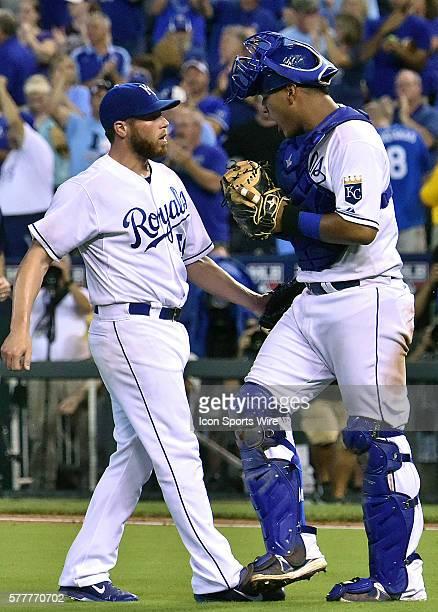 Kansas City Royals' relief pitcher Greg Holland and Kansas City Royals' catcher Salvador Perez celebrate after winning a major league baseball game...