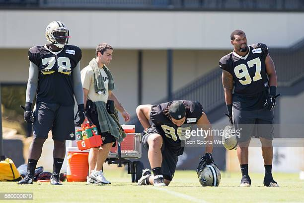 New Orleans Saints defensive tackle Bobby Richardson defensive tackle Tyeler Davison and defensive tackle David Hunter wait on the sidelines during...