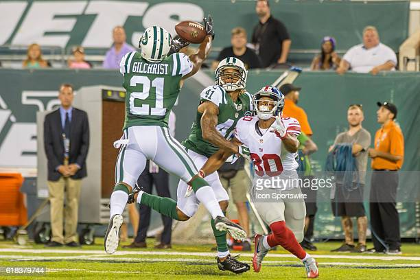 New York Jets free safety Marcus Gilchrist breaks up a pass intended for New York Giants wide receiver Victor Cruz during the NFL preseason game...