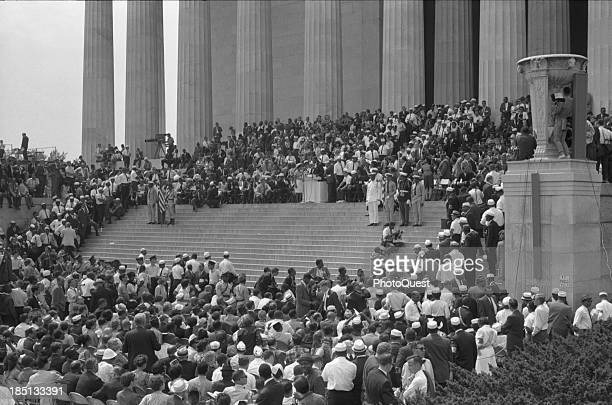 August 28 1968 Photograph shows a military color guard on the steps of the Lincoln Memorial with audience speakers and photographres on all sides