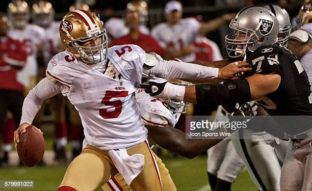 San Francisco 49ers quarterback David Carr fights off Oakland Raiders defensive tackle Chris Cooper on Saturday August 28 2010 at Alameda County...