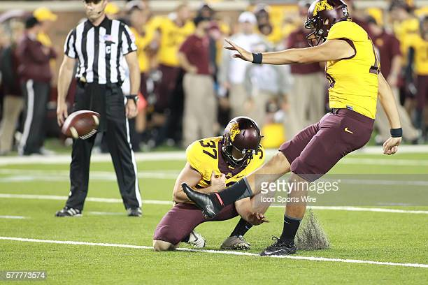 August 28 2014 Gophers kicker Ryan Santoso kicks an extra point while punter Peter Mortell holds it at the Minnesota Gophers game versus Eastern...