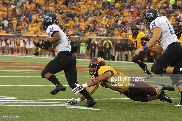 August 28 2014 Gophers linebacker Jack Lynn dives for Panthers running back Shepard Little at the Minnesota Gophers game versus Eastern Illinois...