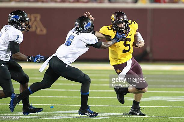 August 28 2014 Gophers quarterback Chris Streveler gives Panthers defensive back Cedric Julius a stiff arm during the second half at the Minnesota...