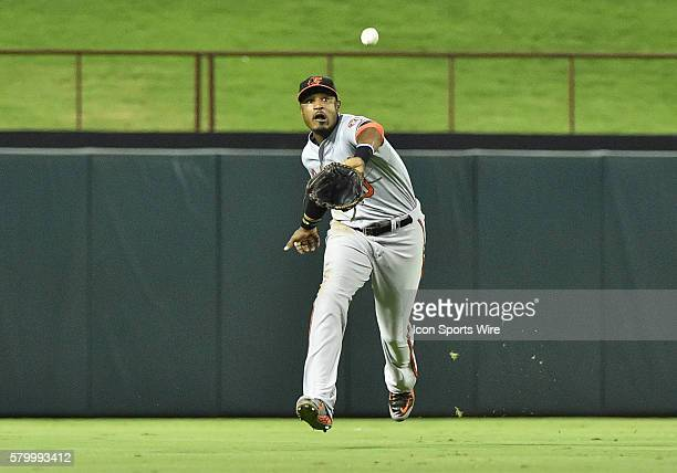 Baltimore Orioles center fielder Adam Jones cannot get to the fly ball in time during a MLB game between Baltimore Orioles and Texas Rangers at Globe...