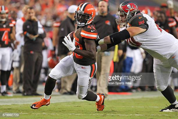 Cleveland Browns cornerback Charles Gaines tries to avoid Tampa Bay Buccaneers guard Logan Mankins after he intercepted the ball in the 1st quarter...