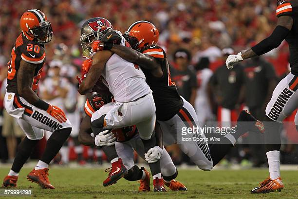 Tampa Bay Buccaneers kick returner Kaelin Clay is tackled by Cleveland Browns cornerback Charles Gaines and Cleveland Browns fullback Malcolm Johnson...