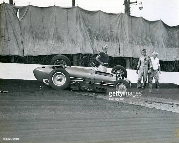 August 30, 1953: Jerry Hoyt awaits help after crashing and flipping the John Zink Special during an AAA Indy Car race on the Milwaukee Mile. Although...