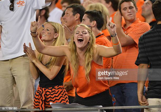 Oklahoma State Cowboys fans celebrates after scoring a touchdown during the Cowboys Classic Florida State at Oklahoma State at ATT Stadium in...