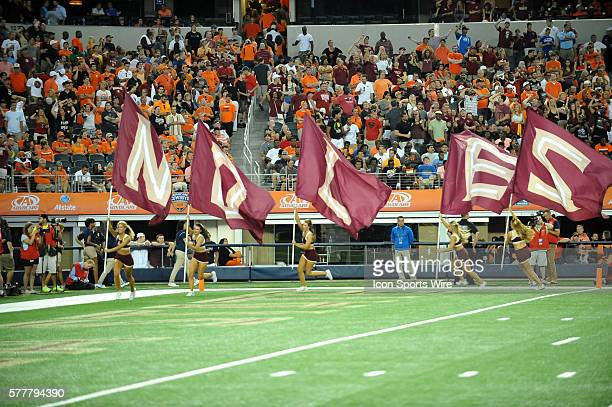 Florida State Seminoles cheerleaders caring the flags on the end zone during the Cowboys Classic Florida State at Oklahoma State at ATT Stadium in...