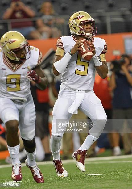 Florida State Seminoles quarterback Jameis Winston passes the ball during the Cowboys Classic Florida State at Oklahoma State at ATT Stadium in...
